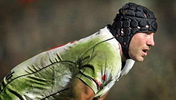Stephen Ferris crunches Lee Byrne in the Heineken Cup opening round