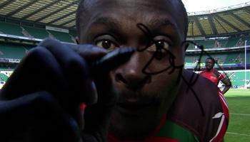 Kenyan Collins Injera celebrates milestone try by signing ball and camera