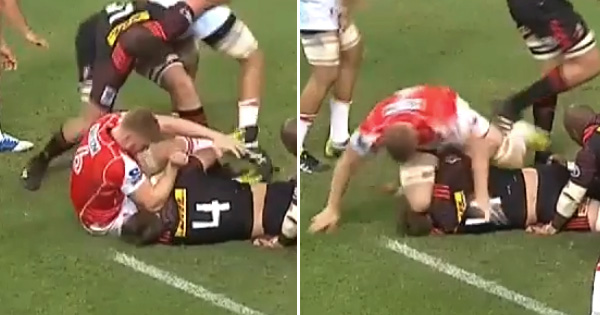 Ed Quirk lashes out with elbow and knee after being held off the ball