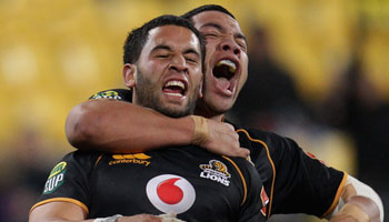 Wellington scrumhalf Frae Wilson smashes Counties lock Jimmy Tupou