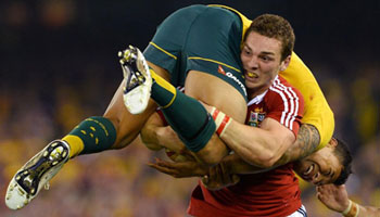 George North picks up and carries tackler Israel Folau