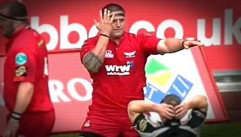 Prop Rhys Thomas scores then celebrates like a back