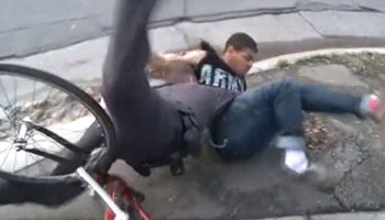 Policeman tackles suspected criminal off bicycle