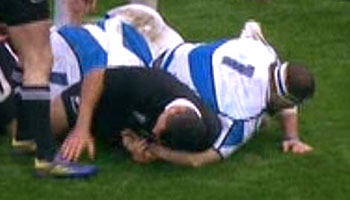 All Black Tamati Ellison arm grabbing with Scotland's Ryan Grant