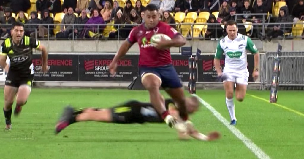 Prop Taniela Tupou gets past two All Blacks as he flies down the wing for Reds try
