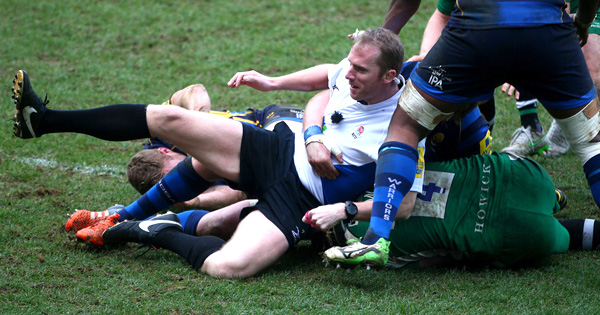 Wayne Barnes ends up on the floor yet again after player takes him down