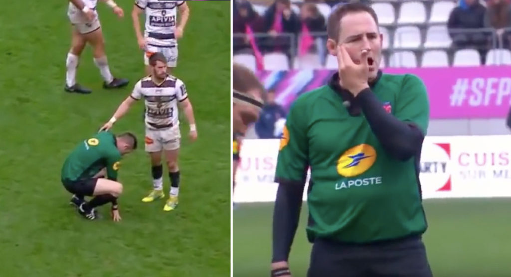 Referee gets big whack in the cheek but toughs it out despite the pain