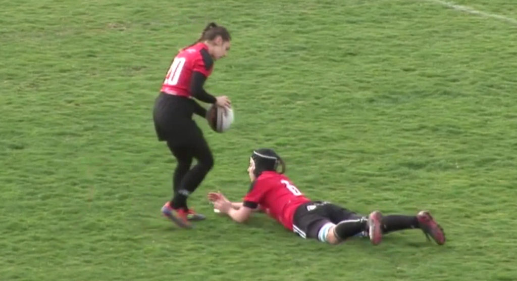 Goal kicker has absolutely no idea where to place the ball, so gets creative with her teammate