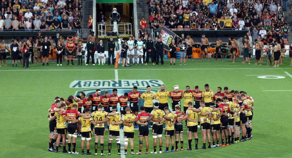 Chiefs and Hurricanes share poignant moment of respect then share the points in New Zealand derby