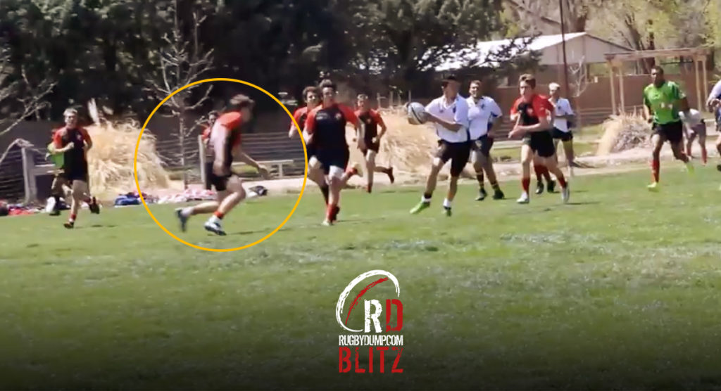 Flanker chops down rudderless runner with thumping legal tackle that is heard from the sideline